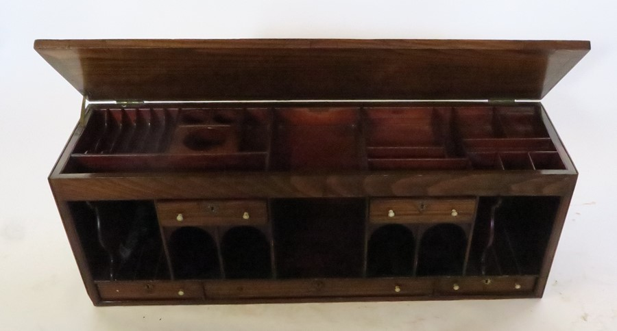 Lot 23 - A bank of drawers and pigeon holes, with turned bone knop handles, the hinged top fitted with