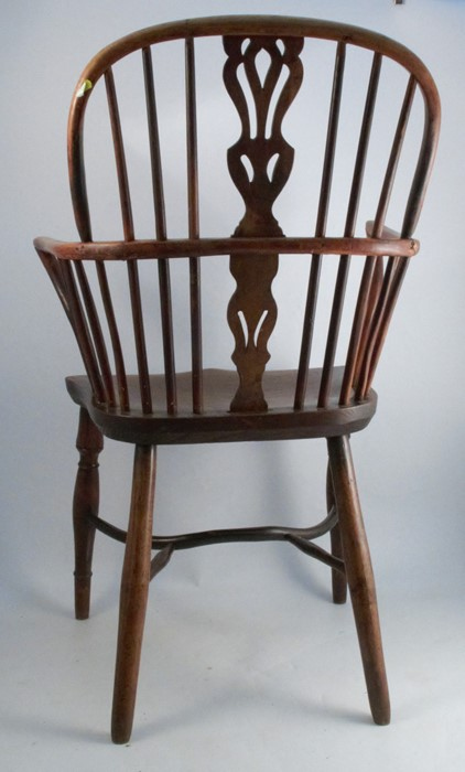 Lot 53 - A 19th century yew wood hoop back Windsor armchair, with a pierced central vase and crinoline