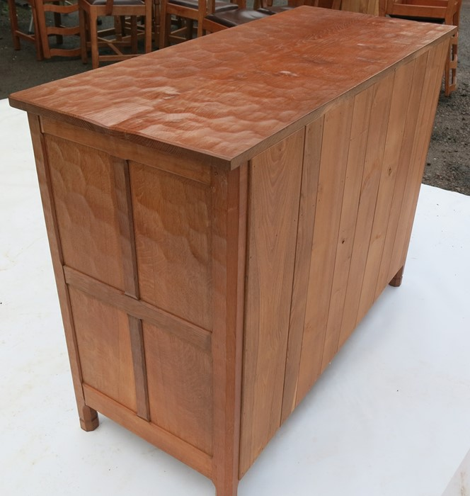 Lot 47 - Alan Grainger Acorn Man, an oak sideboard, fitted with three drawers over a pair of fielded cupboard