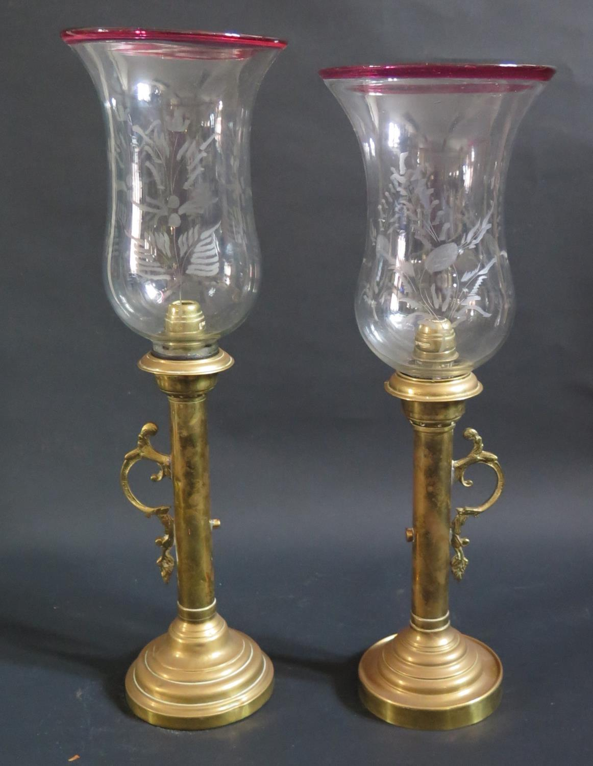 Lot 748 - A Pair of 19th Century Brass Lamps with glass shades