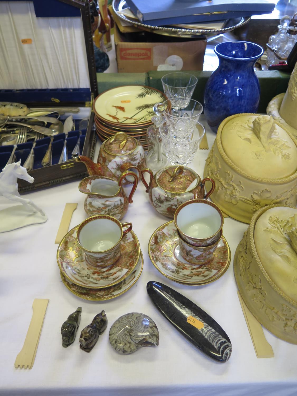 Lot 595 - A Japanese Porcelain Part Tea Service, three cut glass vases, polished fossils etc.