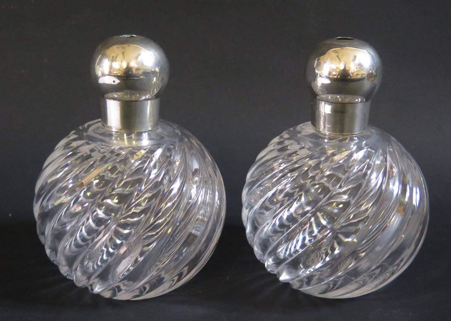 Lot 67 - A Pair of Victorian Silver Top Glass Atomisers (fittings missing), Birmingham 1888?, CM, 13.5cm high