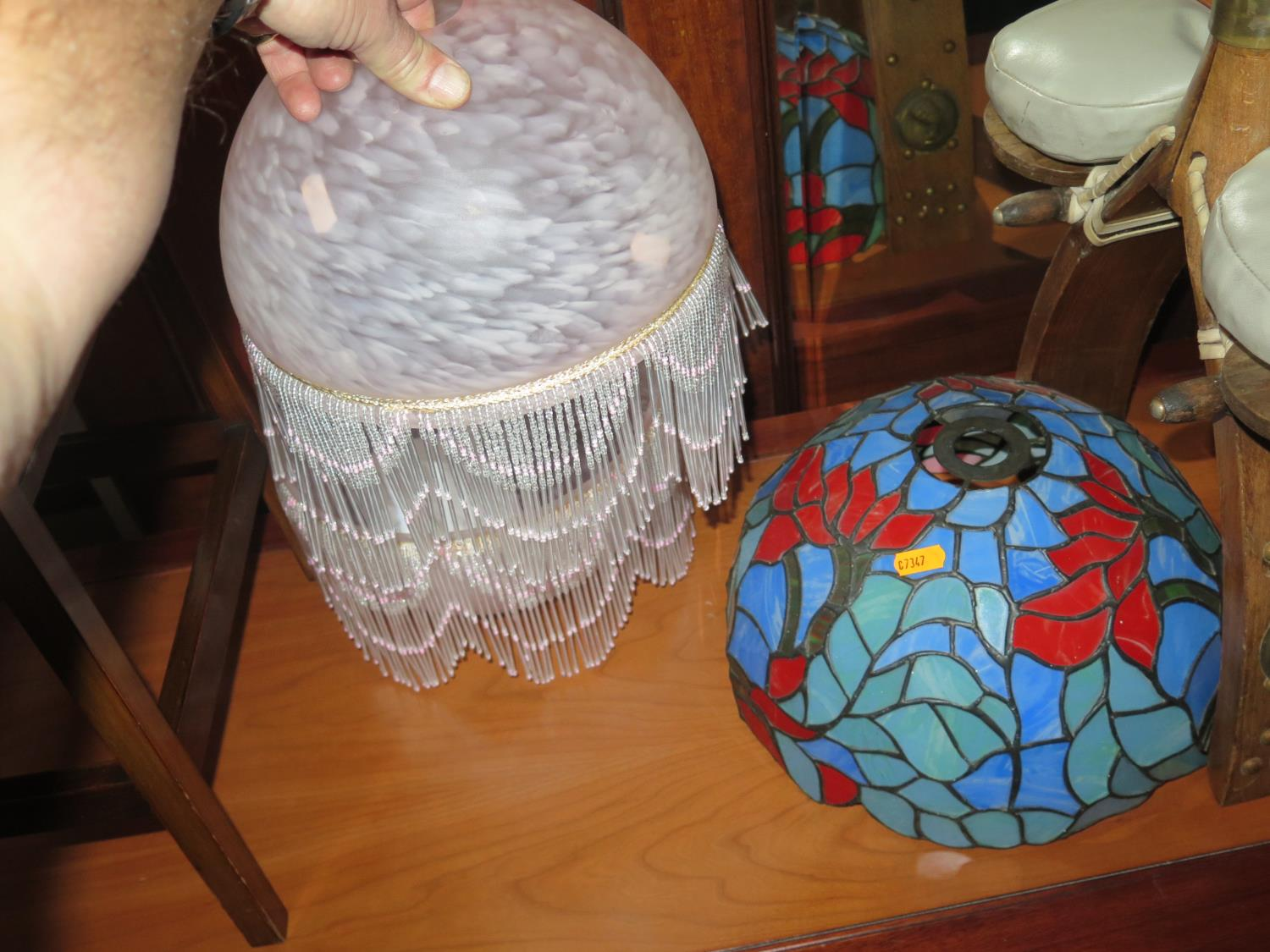 Lot 1065 - A Pair of Glass Lamp Shades with bead Tassels and one coloured and leaded glass shade