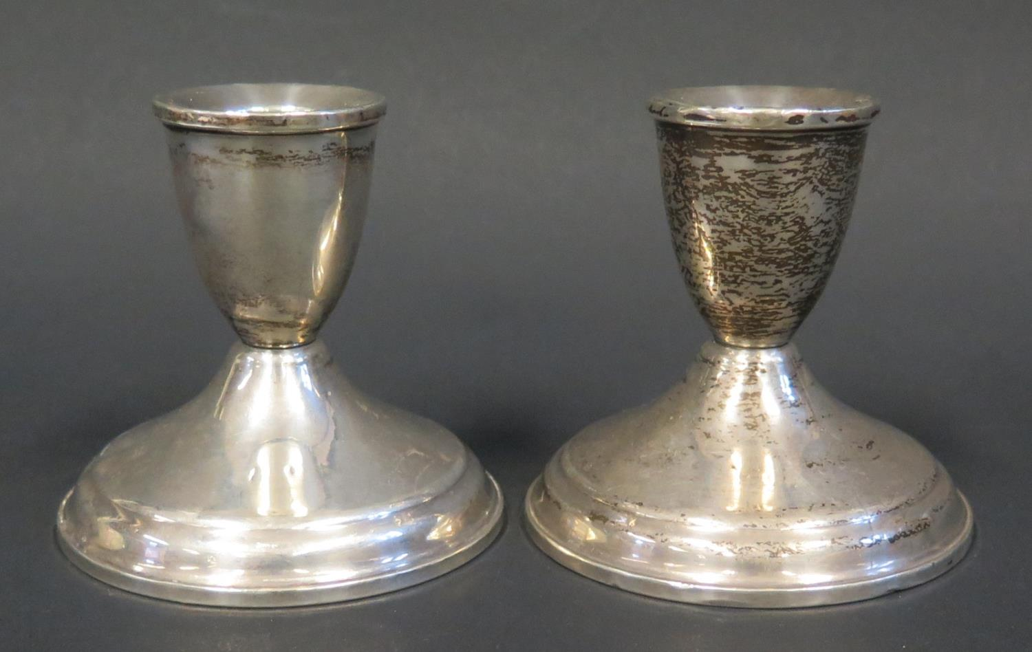 Lot 80 - A Pair of Loaded Silver Candlesticks (8cm) and pair of sterling silver mounted glass ashtrays