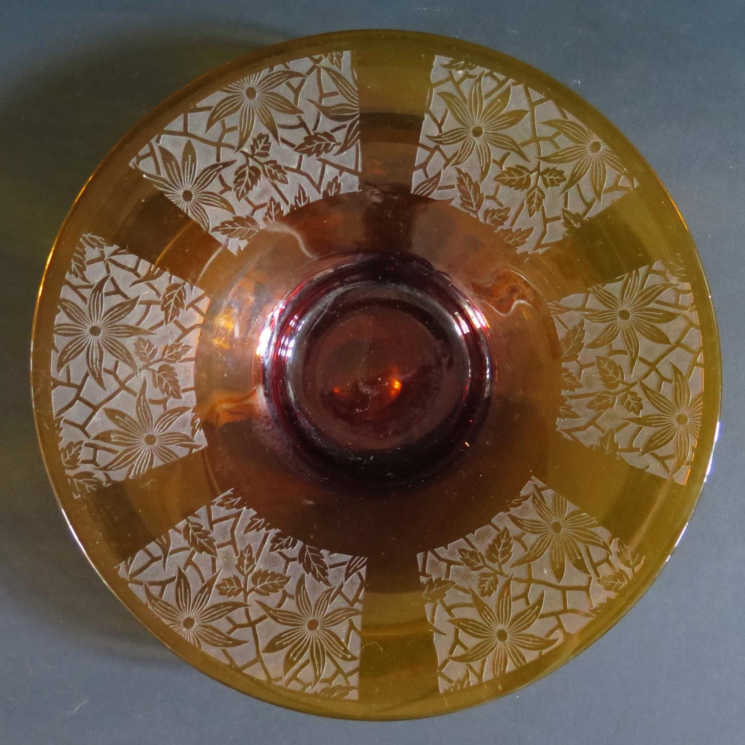Lot 412 - An Amber Glass Shallow Bowl with deep acid etched floral decoration, 30cm diam.