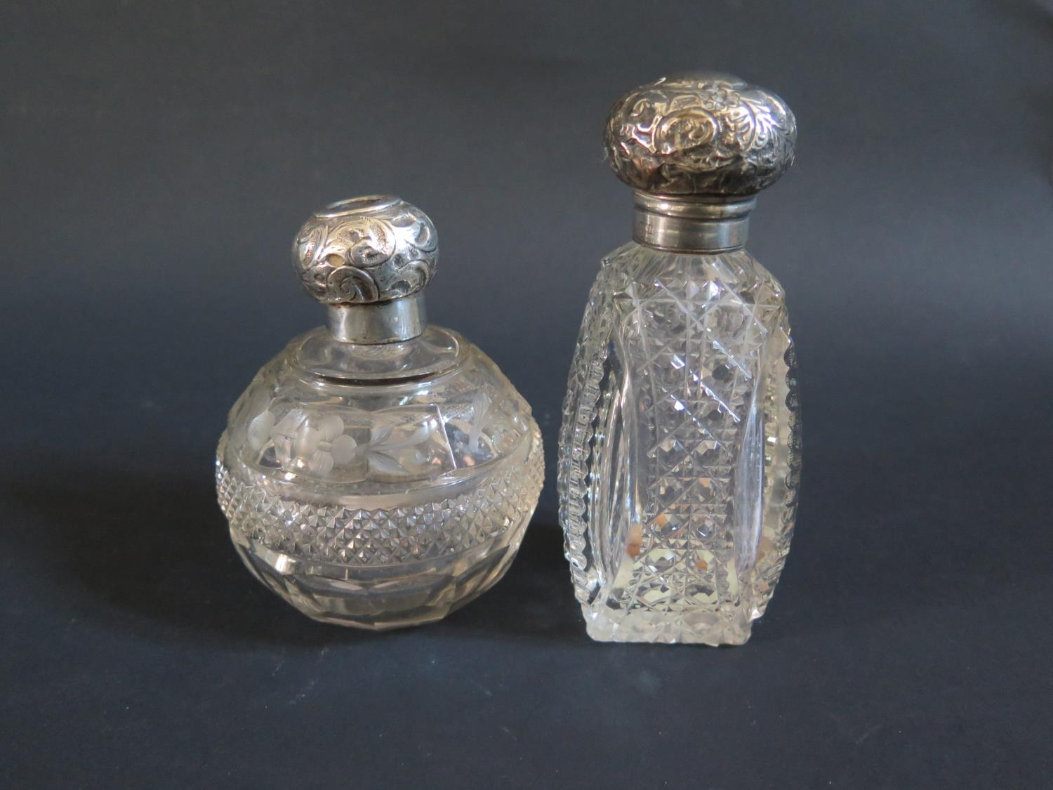 Lot 48 - Two Silver Topped Cut Glass Scent Bottles A/F
