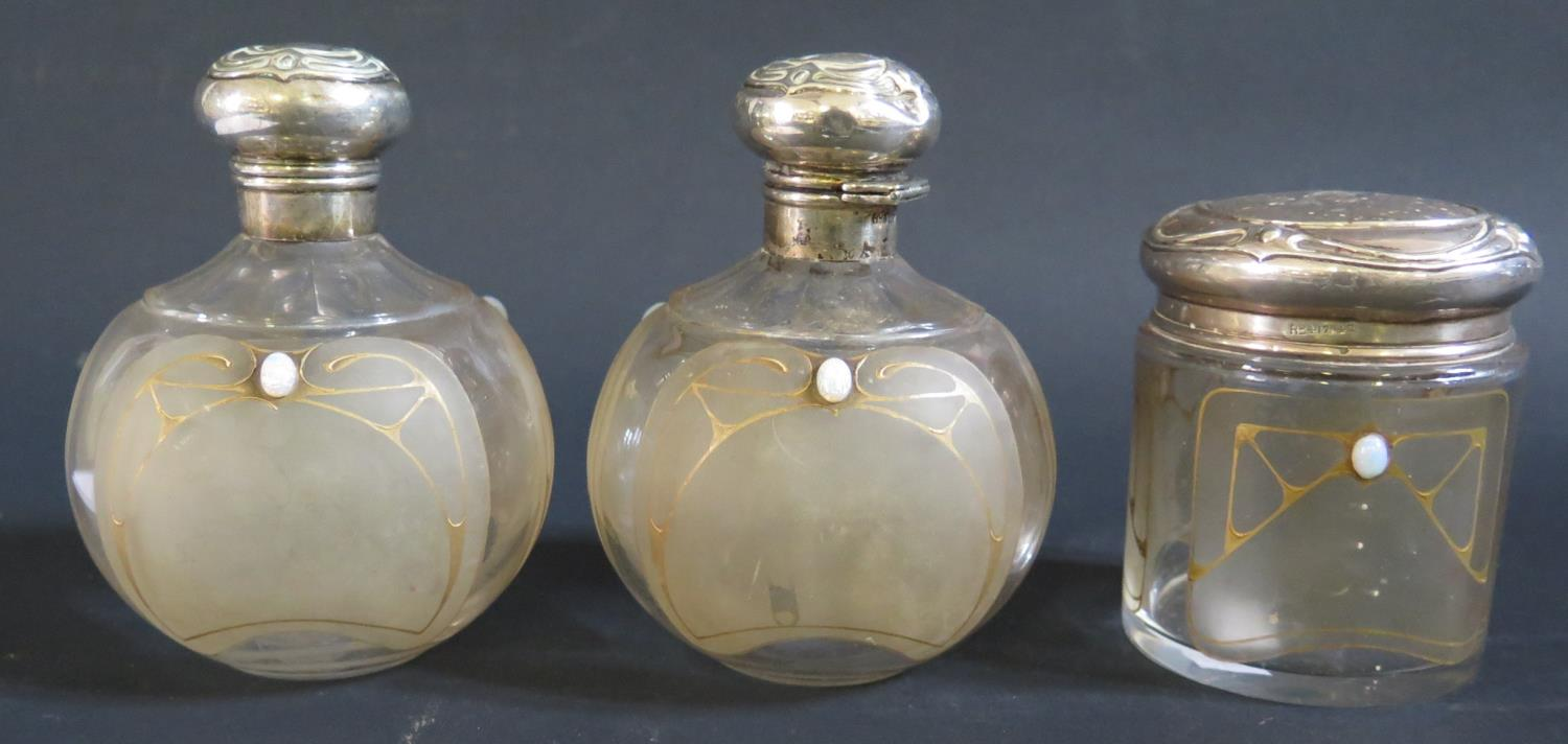 Lot 125 - A Pair of Edward VII Art Nouveau Scent Bottles with slice cut shoulders over three frosted glass