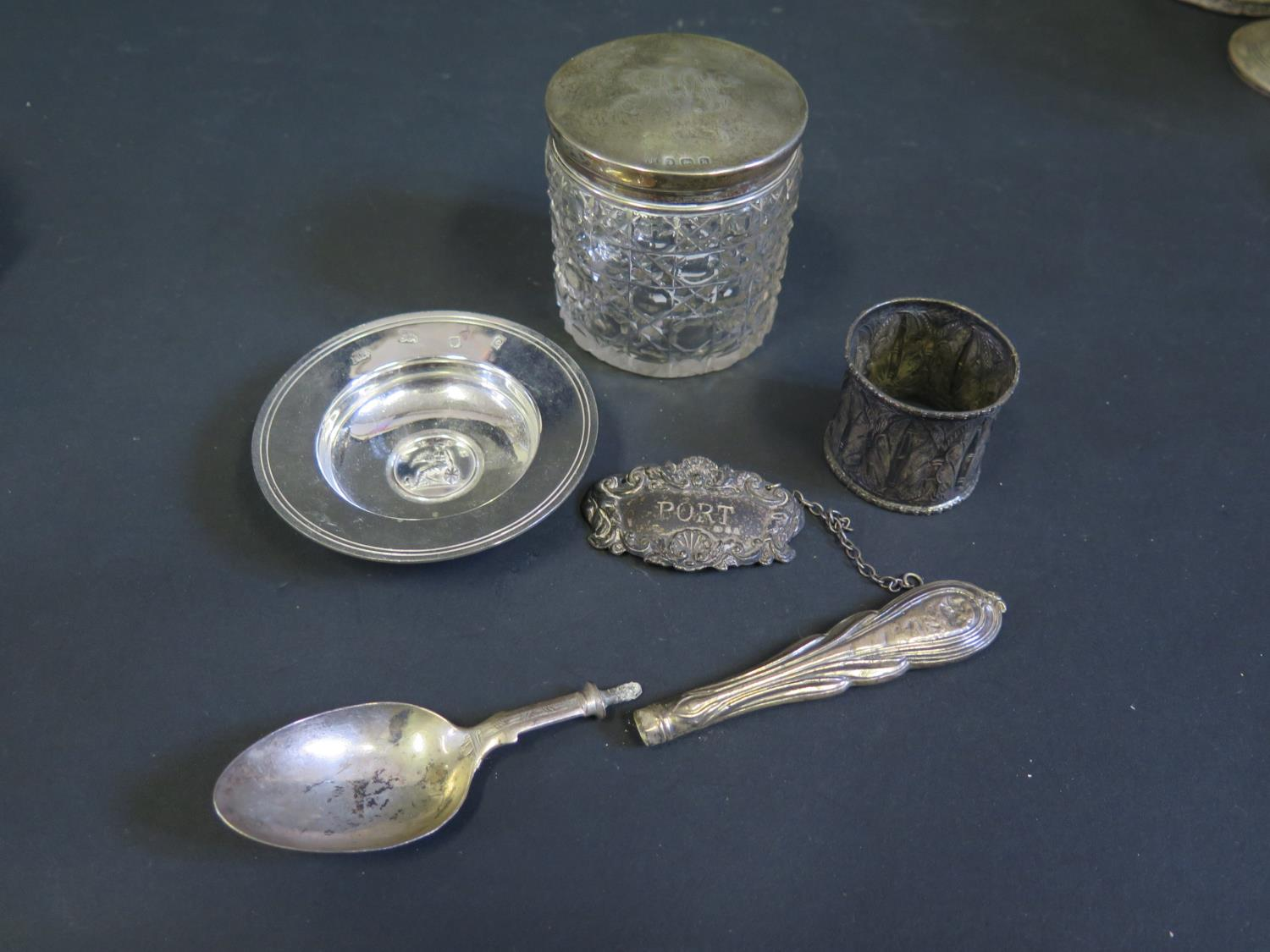 Lot 106 - A Modern Silver Armada Dish, silver PORT label, silver top cut glass dressing table pot and other