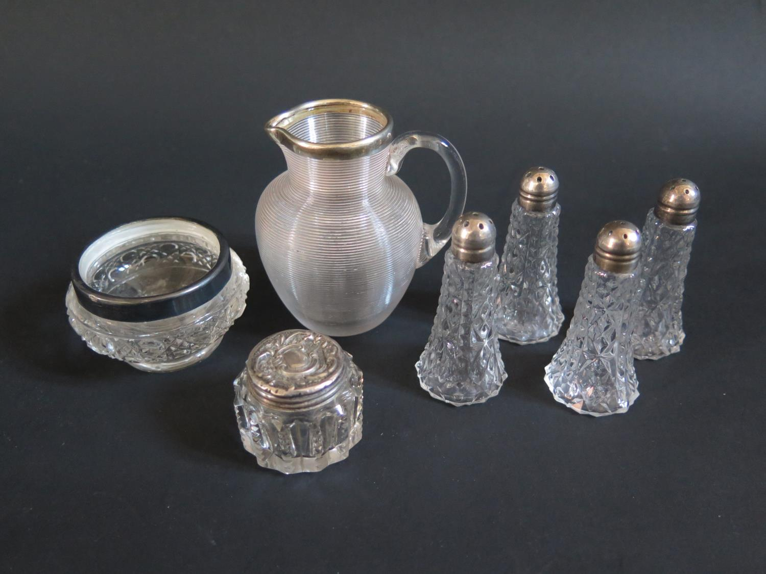 Lot 28 - A Victorian Glass and Silver Mounted Jug (London 1892), silver mounted cruets etc.