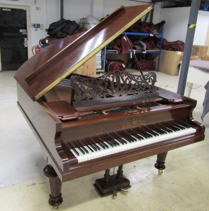 Lot 22 - Richard Lipp (c1915) A 5ft 7in grand piano in a rosewood case on turned legs.
