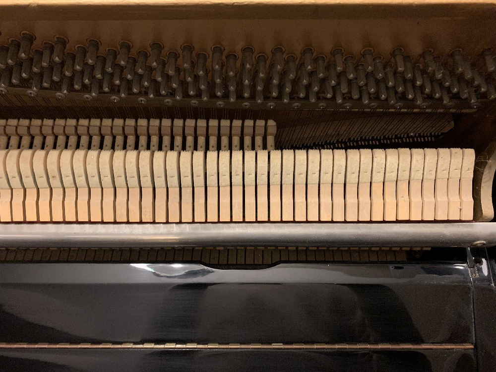 Lot 14 - Knight (c1971) An upright piano in a modern style ebonised case.