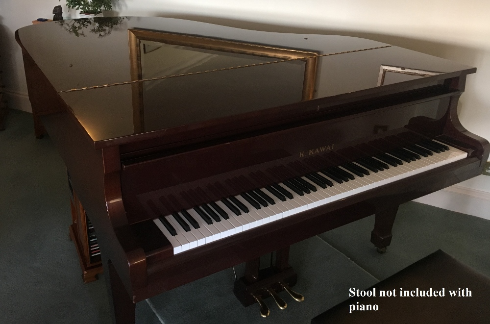 Lot 25 - Kawai (c1979) A 5ft 10in grand piano in a bright mahogany case on square tapered legs.