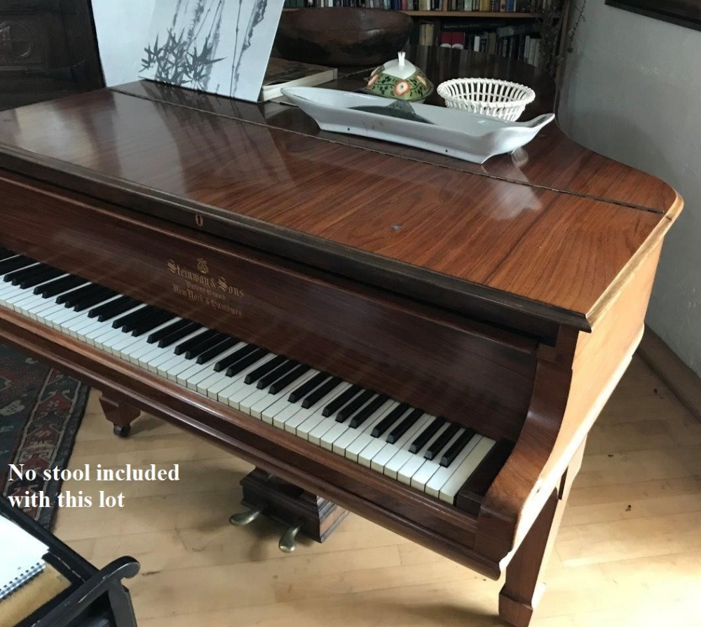 Lot 5 - Steinway (c1906) A 5ft 10in Model O grand piano in a rosewood case on square tapered legs.