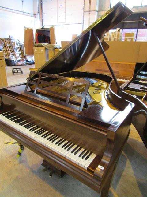 Lot 18 - Blüthner (c1919) A 6ft 3in grand piano in a rosewood case on square tapered legs.
