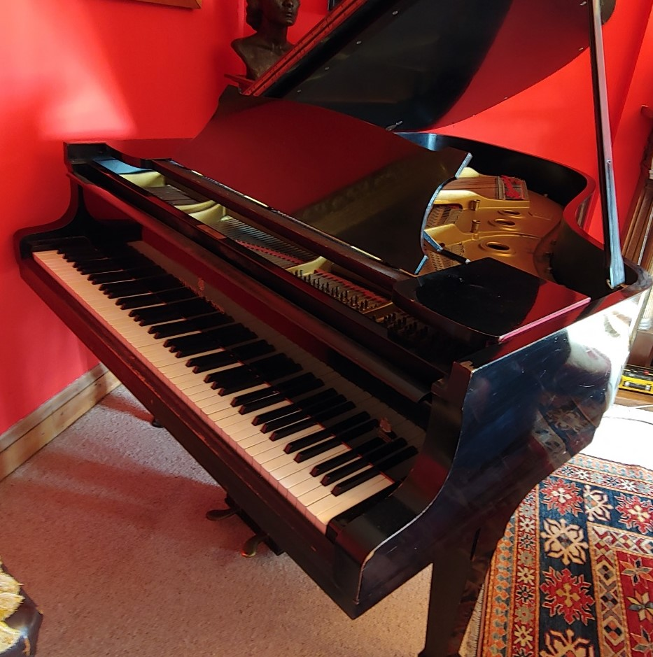 Lot 33 - Steinway (c1939) A 6ft 2in Model A grand piano in an ebonised case on square tapered legs.