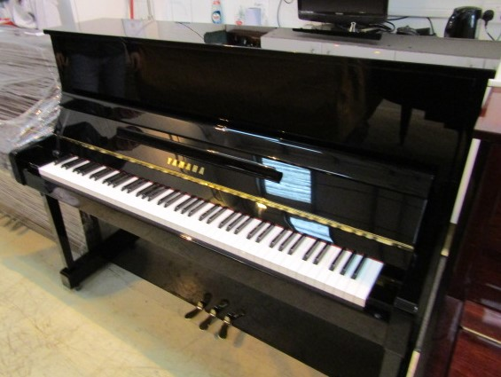 Lot 53 - Yamaha (c2007) A Model YM5 upright piano in a bright ebonised case.
