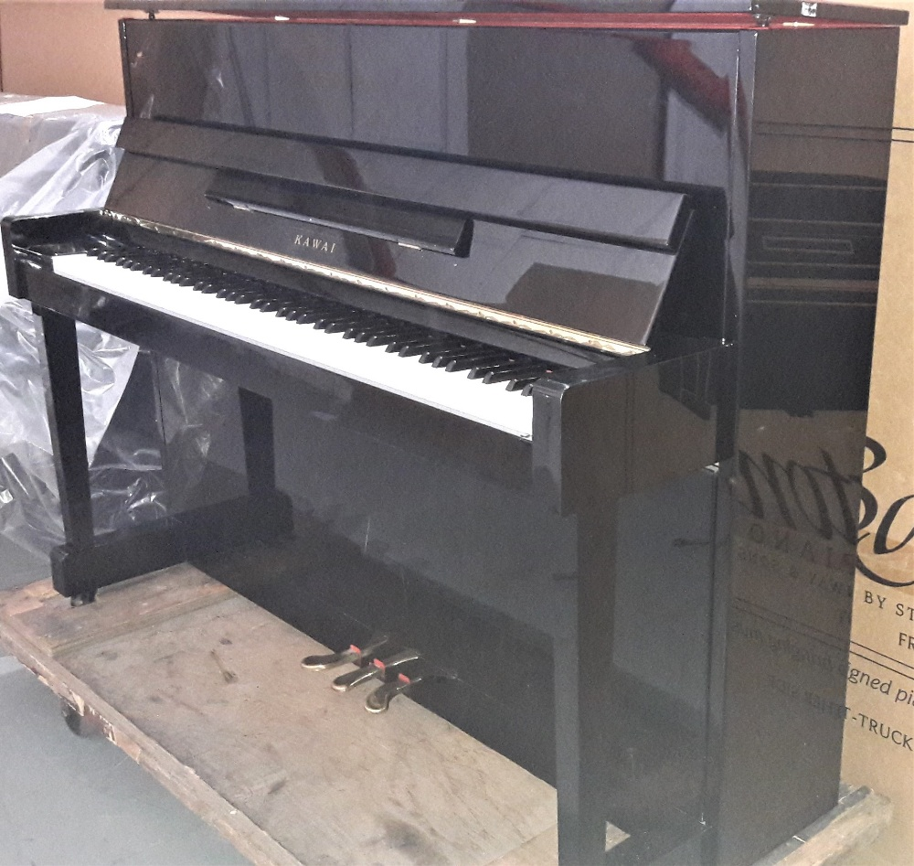 Lot 4 - Kawai (c1997) A Model CX-5H upright piano in a bright ebonised case.