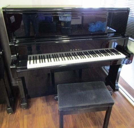 Lot 47 - Kawai (c1977) A 132 cm Model BL71 upright piano in a bright ebonised case;