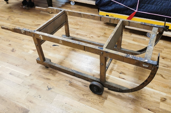 Lot 138 - Piano Trolley An antique trolley made for moving and working on upright pianos.
