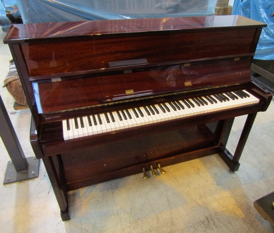 Lot 26 - Challen (c1996) An upright piano in a traditional bright mahogany case.