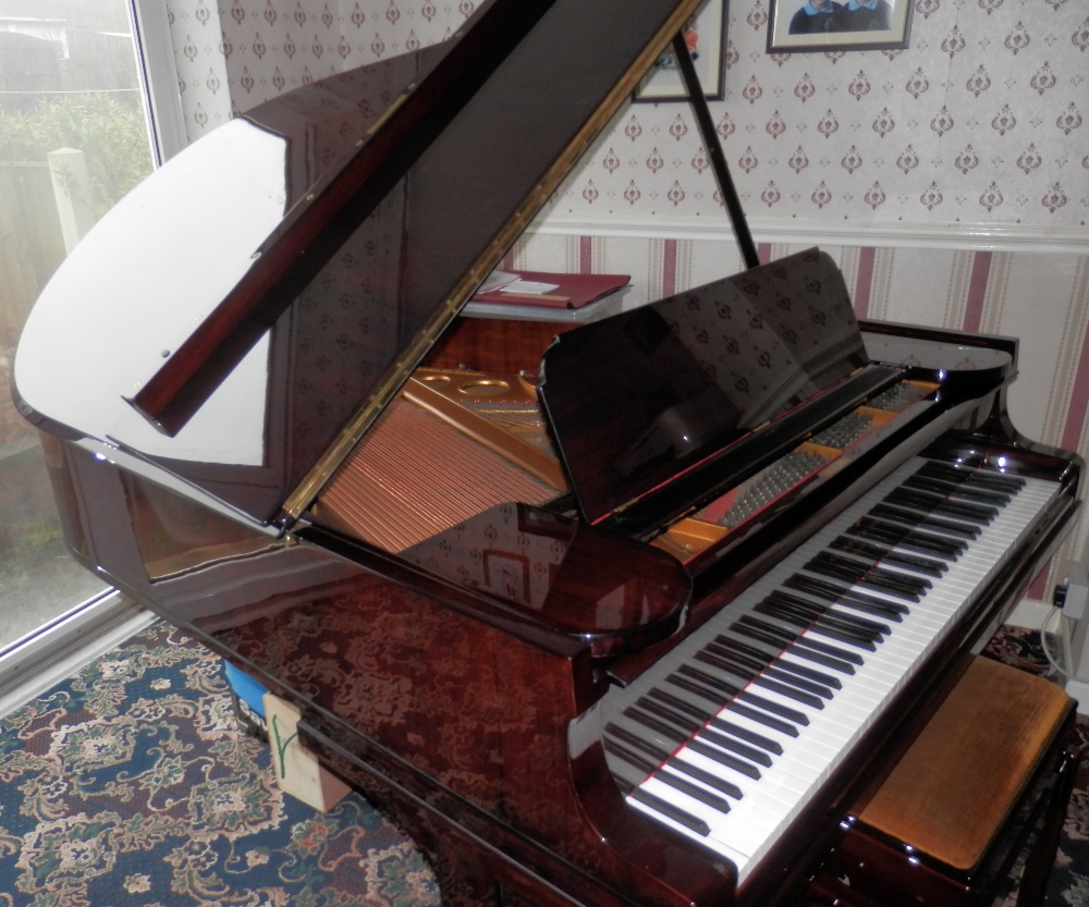 Lot 45 - Steinway (c1914) A 5ft 10in Model O grand piano in a bright rosewood case on square tapered legs.