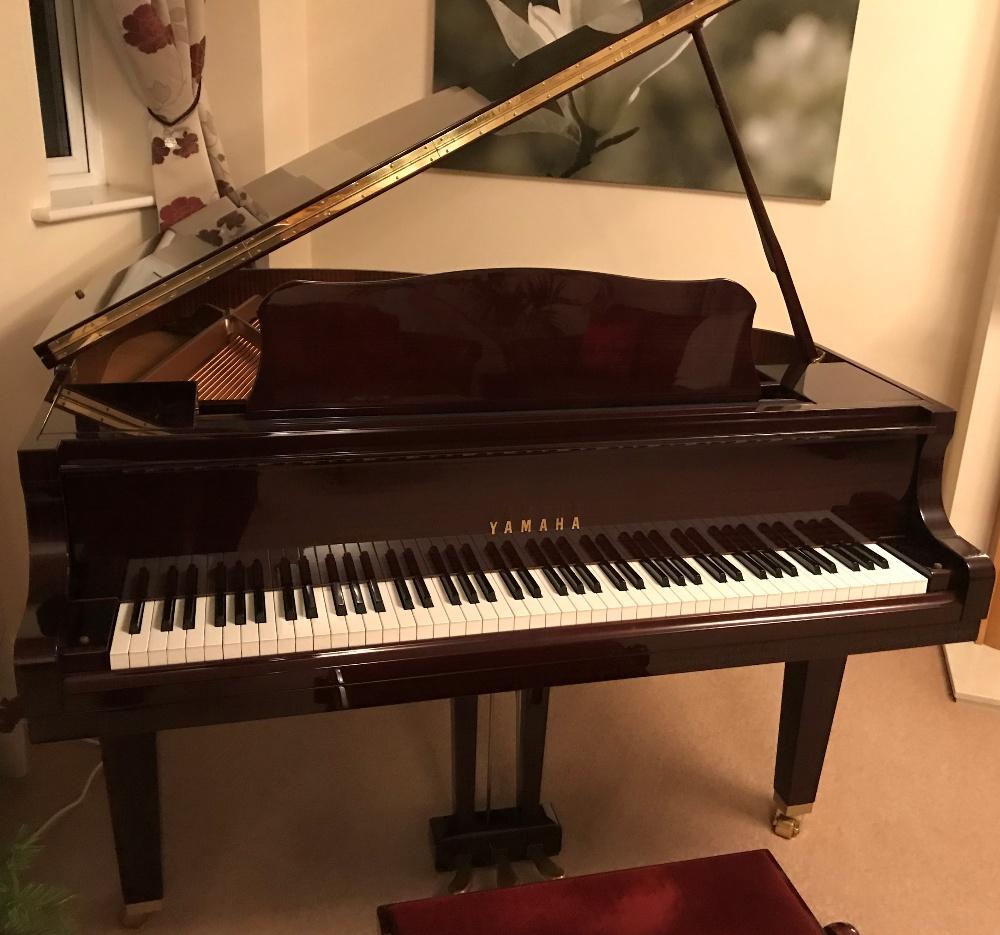 Lot 7 - Yamaha (c1978) AMENDMENT (c2009) A 4ft 11in Model GB1 grand piano in a bright mahogany case on