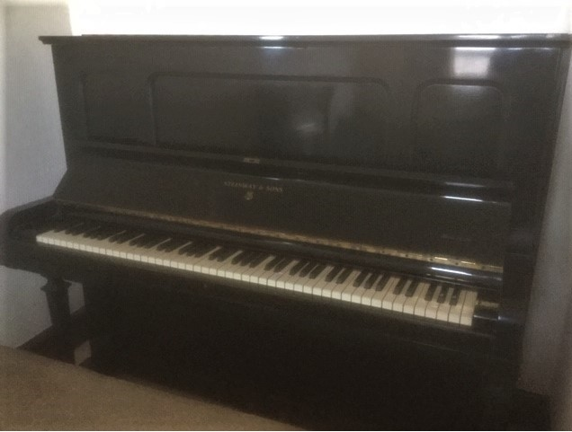 Lot 29 - Steinway (c1920) An upright piano in an ebonised case; together with a duet stool.