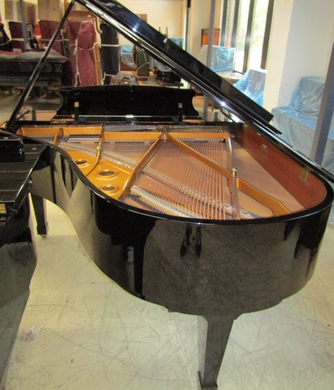 Lot 42 - Kawai (c2009) A 5ft 10in Model RX2 grand piano in a bright ebonised case on square tapered legs.