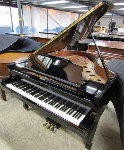 Lot 52 - Kawai (c1989) A 6ft 1in grand piano in a bright ebonised case on square tapered legs.