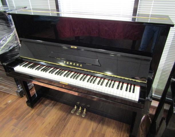 Lot 11 - Yamaha (c1958) A Model U1A upright piano in a bright ebonised case.