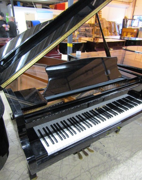 Lot 10 - Kawai (c2010) A 5ft 10in Model RX2H grand piano in a bright ebonised case on square tapered legs.