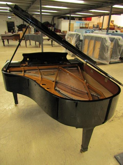 Lot 32 - Kawai (c2009) A 6ft 1in Model RX3 grand piano in a bright ebonised case on square tapered legs.