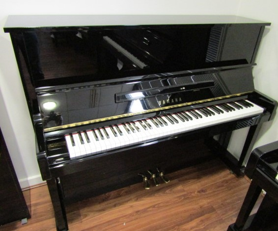 Lot 41 - Yamaha (c1987) A Model U10BL upright piano in a bright ebonised case.