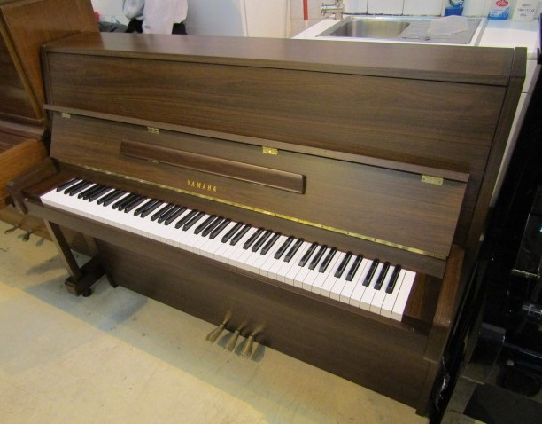 Lot 31 - Yamaha (c1984) A Model MC201 upright piano in a bright mahogany case.