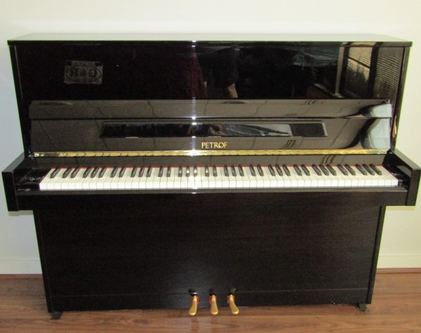 Lot 34 - Petrof (c2011) A Model P118 upright piano in a modern style bright ebonised case.