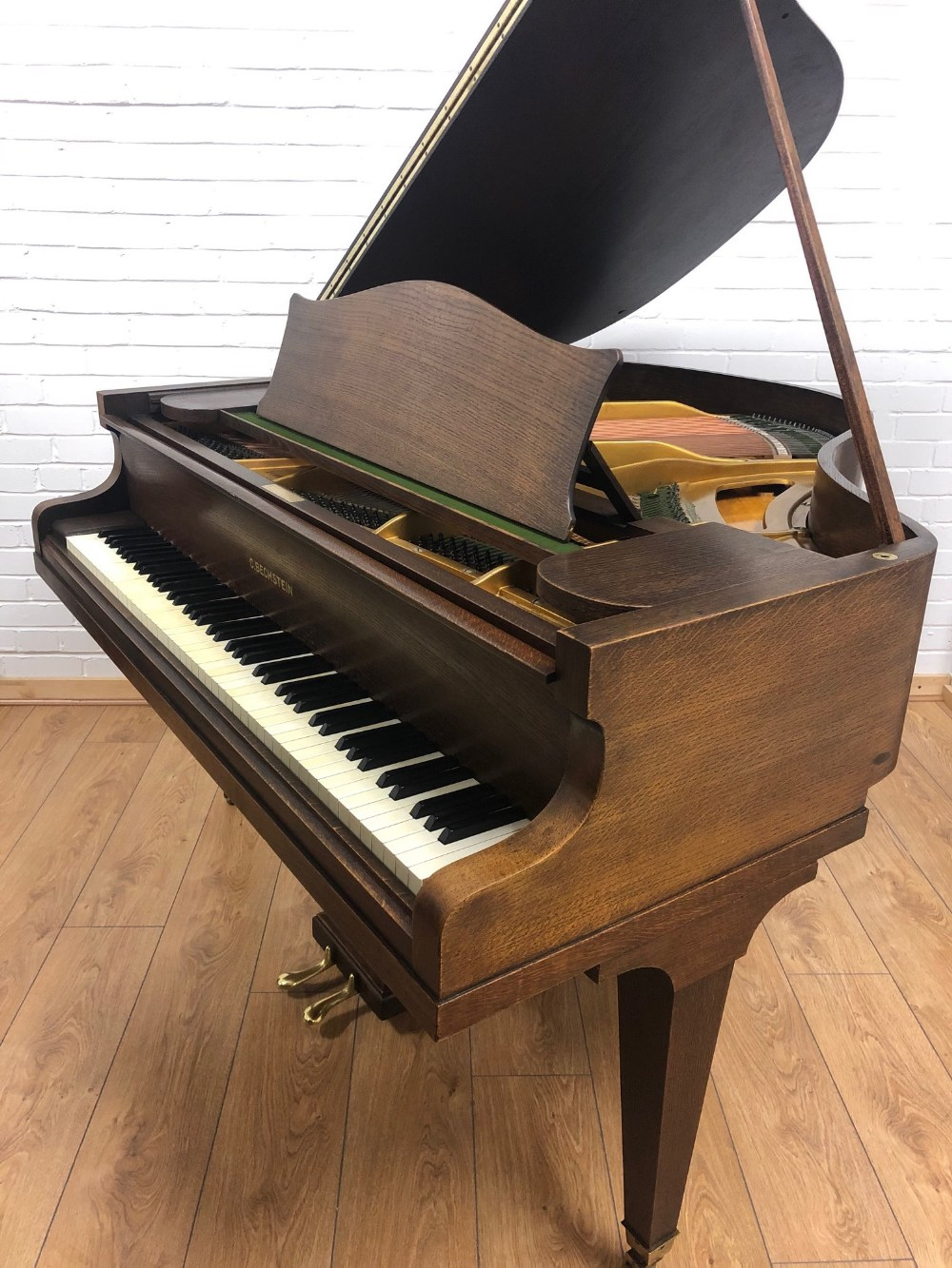 Lot 40 - Bechstein, London (c1930's) A 4ft 8in grand piano in a dark oak case on square tapered legs.