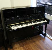 Young Chang (c1987) A Model U-121 upright piano in a bright ebonised case;