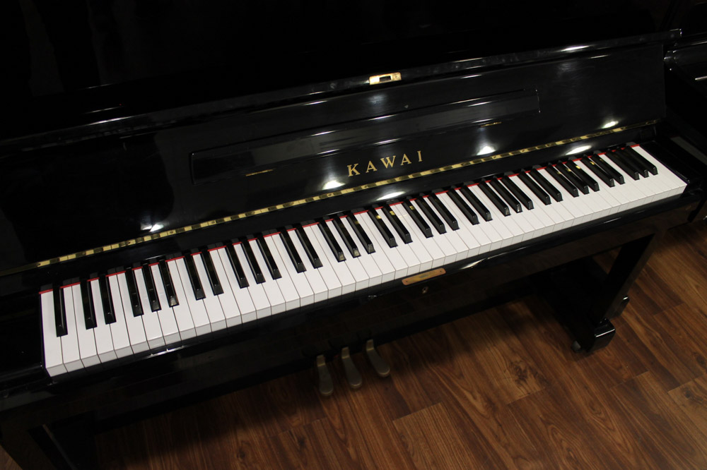 Kawai (c1985) An upright piano in a traditional bright ebonised case; - Image 3 of 5