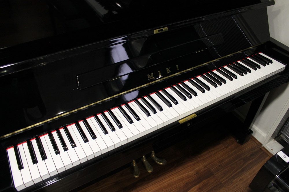 Miki A 121cm Model MU1D upright piano in a bright ebonised case. - Image 4 of 5
