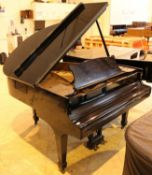 Steinway (c1970) A 5ft 1in Model S grand piano in a bright ebonised case on square tapered legs;