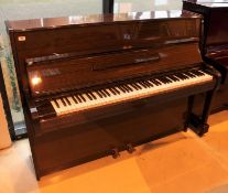 Bechstein (c1981) A 112cm Model 12N upright piano in a mahogany case; together with a stool.
