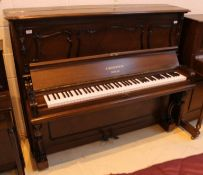 Bechstein (c1900's) A Louis XV-style upright piano in a quarter veneered mahogany case with
