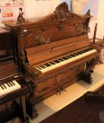 Berdux (c1892) No 4815 An upright piano in a carved mahogany Rococo case decorated with shell and