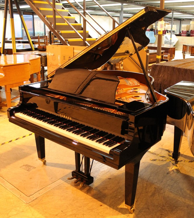 Yamaha (c2009) A 5ft 6in Model GC2 grand piano in a bright ebonised case on square tapered legs;