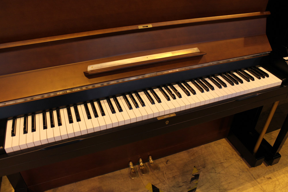 Yamaha (c1958) A Model U3B upright piano in a brown and black satin case. - Image 4 of 5