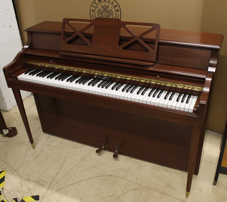 Knight (c1972) An upright piano in a colonial style mahogany case.