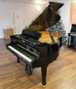 Fazioli (c2006) A 5ft 2in Model 156 grand piano in a bright ebonised case on square tapered legs;