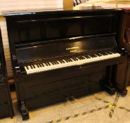 Bechstein (c1891) An oblique strung upright piano in an ebonised case.