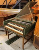 Double Manual Harpsichord A Double manual harpsichord in a green painted case on a trestle base.