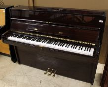 Elysian A recent upright piano in a modern style bright mahogany case;